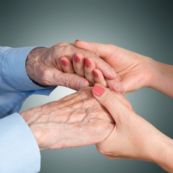 holding a senior citizen's hands